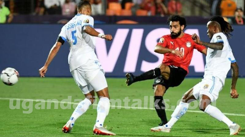 Salah's first powerful strike when surrounded by two DR Congo players